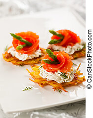 Potato pancakes topped with smoked salmon, asparagus and ...