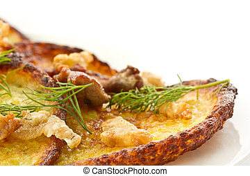 potato pancakes with fried bacon and dill