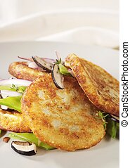 Potato pancakes with mushrooms and vegetable