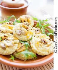 potato pancakes with mushrooms, closeup