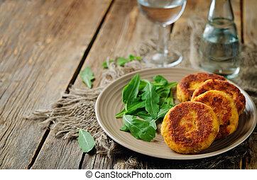 Potato pumpkin burgers with arugula