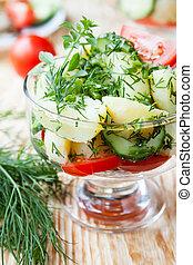 potato salad in a transparent bowl