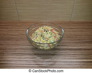 Potato salad with vegetables, eggs and olive oil, in a glass bowl