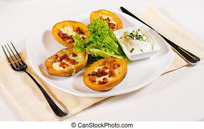 Potato Skins Appetizer Served in Restaurant