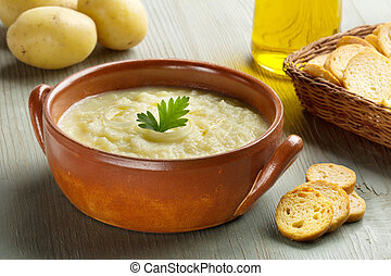 potato soup, croutons, oil and raw potatoes