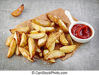 Potato wedges and tomato sauce