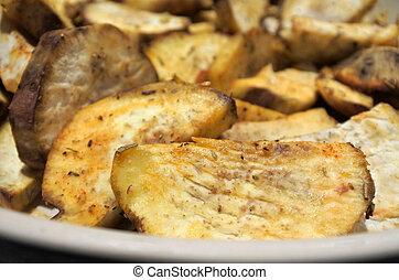 Potato wedges food background