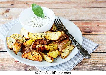 potato wedges with a cream sauce, food closeup
