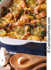 potato with bacon and mushrooms in baking dish. vertical
