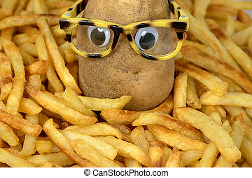 Potato with glasses in fries - whole potato with eyeglasses ...