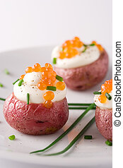 Potato with red cavi - Roasted red potato topped with cream,...