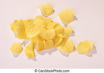 Potatoe Chips on white Background - Kartoffelchips vor weissem Hintergrund