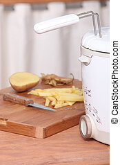 Potatoes and electric fryer
