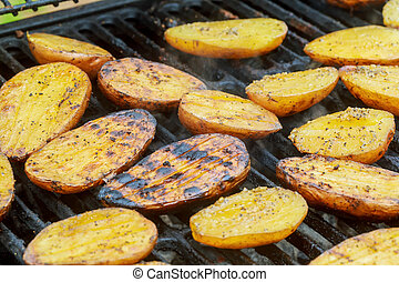Potatoes, and meat roasted on skewers BBQ grill