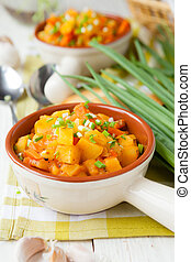 Potatoes cooked in the oven with carrots