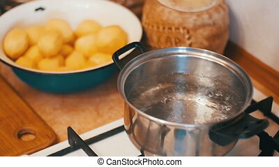 Potatoes Flies into a Pot of Boiling Water in the Home...