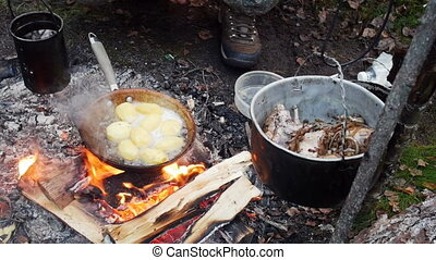 Potatoes fried in a pan in outdoor