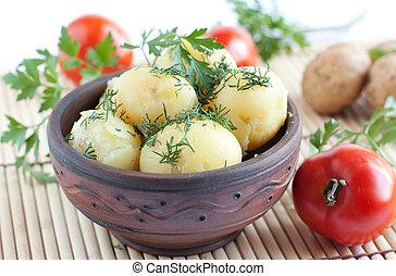 Potatoes in a ceramic bowl, handmade