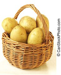 Potatoes in basket, isolated - Unpeeled potatoes in basket ...