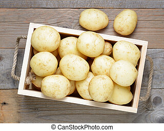Potatoes in wooden box top view