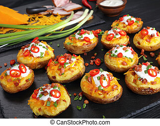potatoes loaded with cheese, bacon, cream