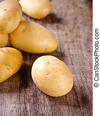 Potatoes on a chopping board