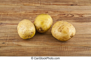 Potatoes on a wooden background