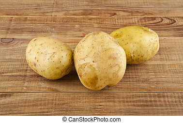 potatoes on a wooden table close-up