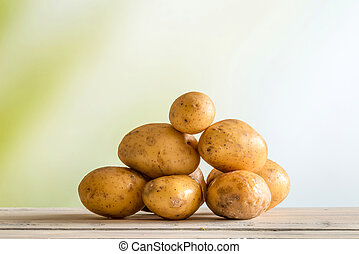 Potatoes on a wooden table