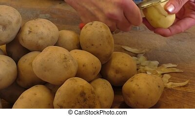 Potatoes on wooden table