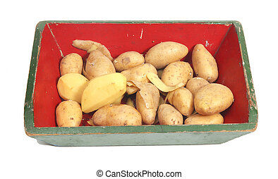 Potatoes peeled and unpeeled in crate