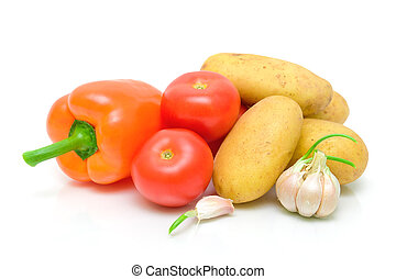 potatoes, peppers, tomatoes and garlic on a white background