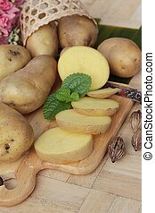 Potatoes raw vegetables with slices for cooking.