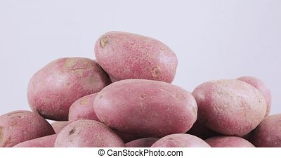 Potatoes red bulk on table - Young washed red potatoes on...