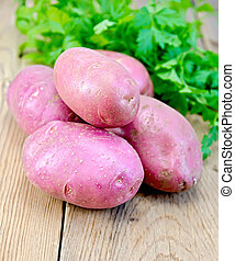 Potatoes red with parsley on the board