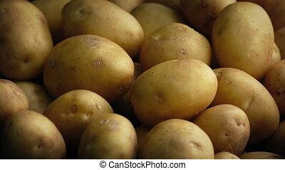 Potatoes Rotating Closeup - Pile of potatoes turning slowly...