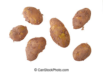 Potatoes - A collection of Jersey Royal potatoes isolated on...