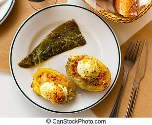 Potatoes stuffed with bacon, greens and eggs