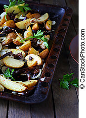 potatoes with mushrooms and onions on a baking sheet