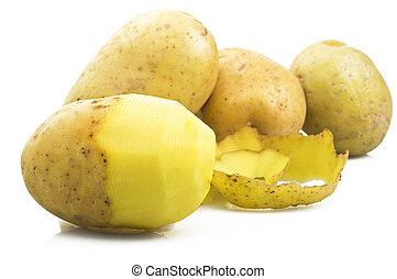 Potatoes with peeled potato on the white