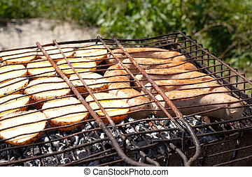 potatoes with sausages on hot coals, the process of cooking ...