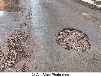 road - Pothole in road after spring thaw