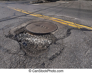 Pothole - Deep pothole caused by freezing and thawing during...
