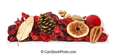 Christmas themed potpourri in a rectangular dish isolated against white