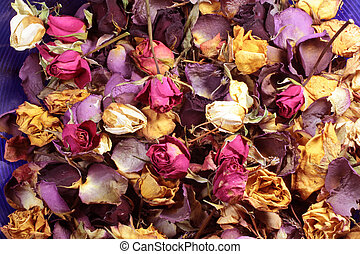Close-up of a potpourri of colorful dried roses