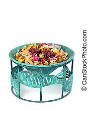 Potpourri in flowerpot on a white background