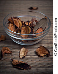 Zen-like composition with bowl of scented potpourri