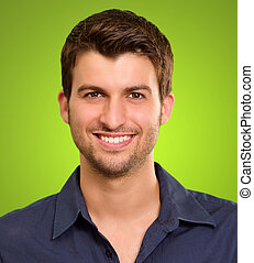 Potrait of a man holding flag on green background