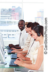 Man smiling at camera in a call centre