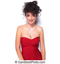 smiling young woman wearing a sexy red dress.